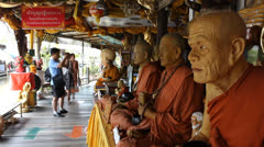 Statues of monks at Pattaya floating market. Stock Footage