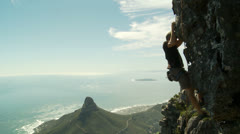 Rock climber scales rock on Table Mountain Stock Footage