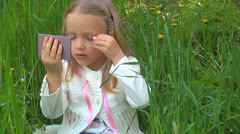 Little Girl Makeup Herself, Child Playing in Grass, Children Imitating Adults Stock Footage