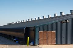 commercial poultry farming building - stock photo