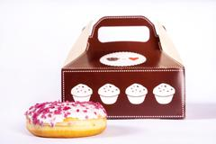 donut in front of box - stock photo