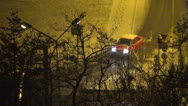 Stock Video Footage of Traffic on a Snowy Night, Snow Fall on the Road, Winter Scene, View