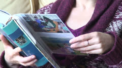 Lady with photo album (3) - stock footage
