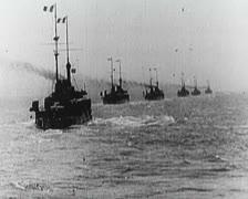 World War 1 - Warships at sea, firing and loading Stock Footage