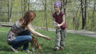 Stock Video Footage of Mom and daughter give to drink with water  dog