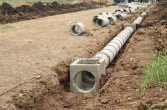 concrete drainage tank - stock photo