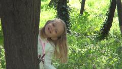 Little Girl Hiding behind Tree, Child Playing Hide and Seek in Forest, Children Stock Footage