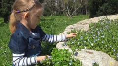Girl Picking Veronica Persica Flowers in Park, Child Playing in Grass, Children Stock Footage