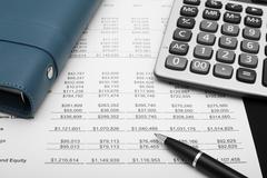 Business financial chart analysis with pen, notebook & calculator Stock Photos
