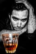 Black and white grunge portrait of a drunk and depressed hispani Stock Photos