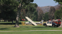PLANE CRASH ON GOLF COURSE Stock Footage