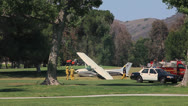 Stock Video Footage of PLANE CRASH ON GOLF COURSE