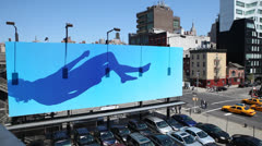 Large Billboard Displaying Artwork in New York City Stock Video Stock Footage