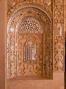 closeup of white stucco and mirror decoration in the interior wall of histori - stock photo