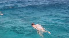 Woman Snorkelling in Water Stock Footage
