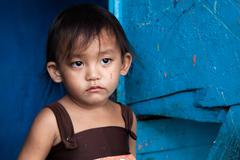 Young Asian girl living in poverty - stock photo