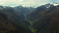 slow aerial landscape shot of valley with mountains, very high, Tyrol / Austria - stock footage