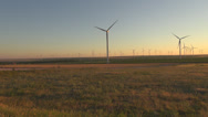Stock Video Footage of Wind Turbine at sunset - Green Energy
