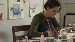 Female Artist working on a drawing - stock footage