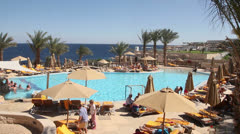 Swimming Pool at Hotel, overlooking Sea Stock Footage