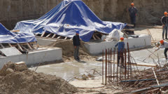 Bulders working at construction site Stock Footage