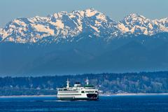Seattle bainbridge island ferry puget sound olympic snow mountains washington Stock Photos