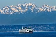 Seattle bainbridge island ferry puget sound olympic snow mountains washington Stock Photos