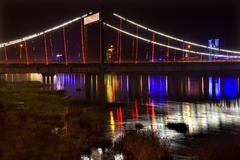 jiangqun bridge at night reflections fushun china - stock photo