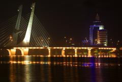 tianhu bridge fushun liaoning china at night with reflections - stock photo