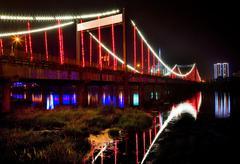 red lights jiangqun general bridge at night fushun city, liaoning - stock photo