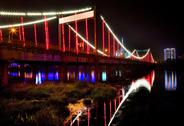 Stock Photo of red lights jiangqun general bridge at night fushun city, liaoning