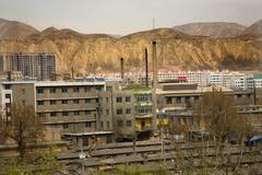 Chinese factory with chimneys apartments gansu province, qinghai Stock Photos