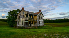 Sun Setting over Abandoned Home HDR 4K Timelapse Stock Footage