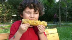 Little Boy eating corn Stock Footage