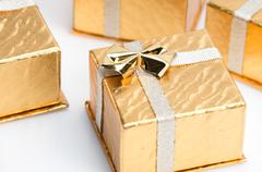 small gold christmas presents - stock photo
