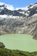 Stock Photo of El Altar Volcano In Sangay National Park Ecuador The Green Crater Lake Is The