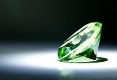 faceted green gemstone - stock photo