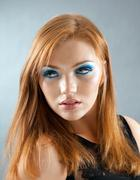 portrait of a redhead female model - stock photo