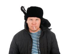 russian man in winter fur cap  ,red-neck. - stock photo