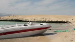 Boat Moored on an Island Shore Stock Footage