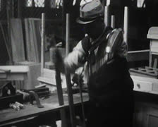 World War 1 - Disabled sawing wood with prosthesis Stock Footage