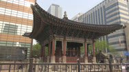 Stock Video Footage of Korean Temple surrounded by modern buildings, Seoul, South Korean
