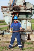 Oil worker with pipe wrench Stock Photos
