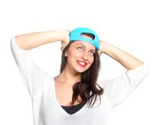 attractive young woman wearing a blue baseball cap - stock photo