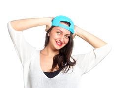 Stock Photo of attractive young woman wearing a blue baseball cap