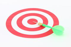 light green dart on center of target. - stock photo