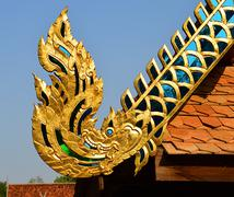 the old wooden naga on roof - stock photo