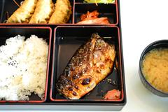 """Japanease food box """"bento"""" with grill saba fish and miso soup Stock Photos"""