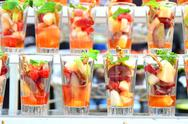 Salad with fresh fruits and berries in glass Stock Photos