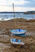 Sailing boats at ebb tide near st. malo in brittany, france Stock Photos